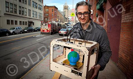 "Co-founder Bre Pettis holds a three-dimensional printer ""The Replicator"" in front of Makerbot Industries LLC manufacturing location in Brooklyn"
